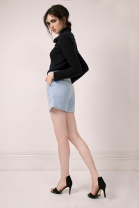 Bowtie cashmere knit, €205; summer canvas shorts, €125, all Lennon Courtney.